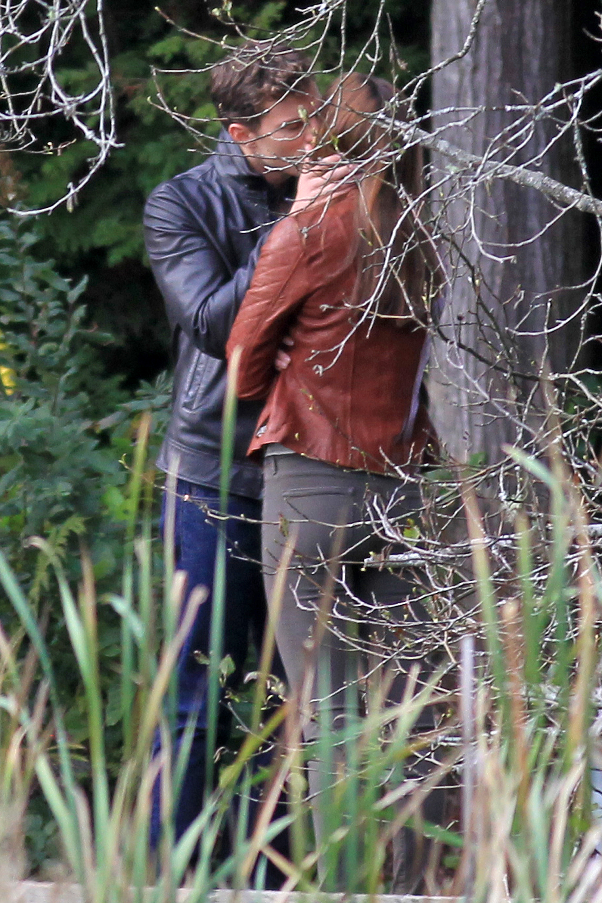Jamie Dornan steals a kiss from Dakota Johnson for 'Fifty Shades of Grey'