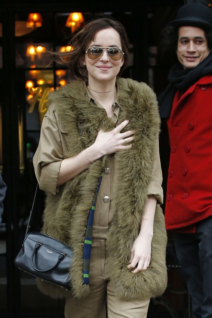 Dakota Johnson wears fur while exiting the Bowery Hotel in New York City