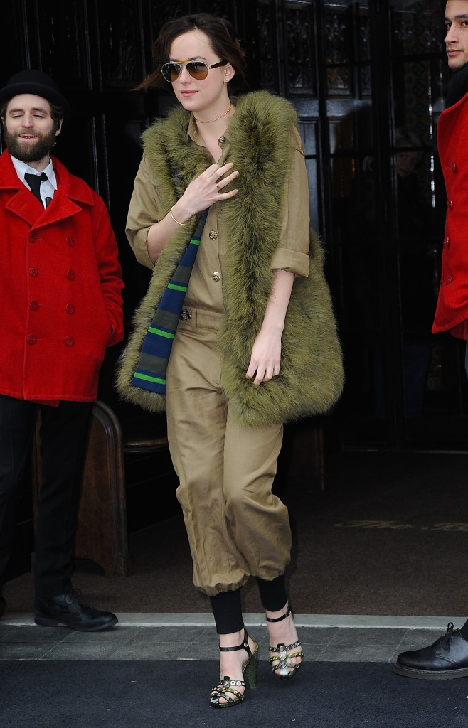 Dakota Johnson leaves her hotel in green fur coat today in NYC