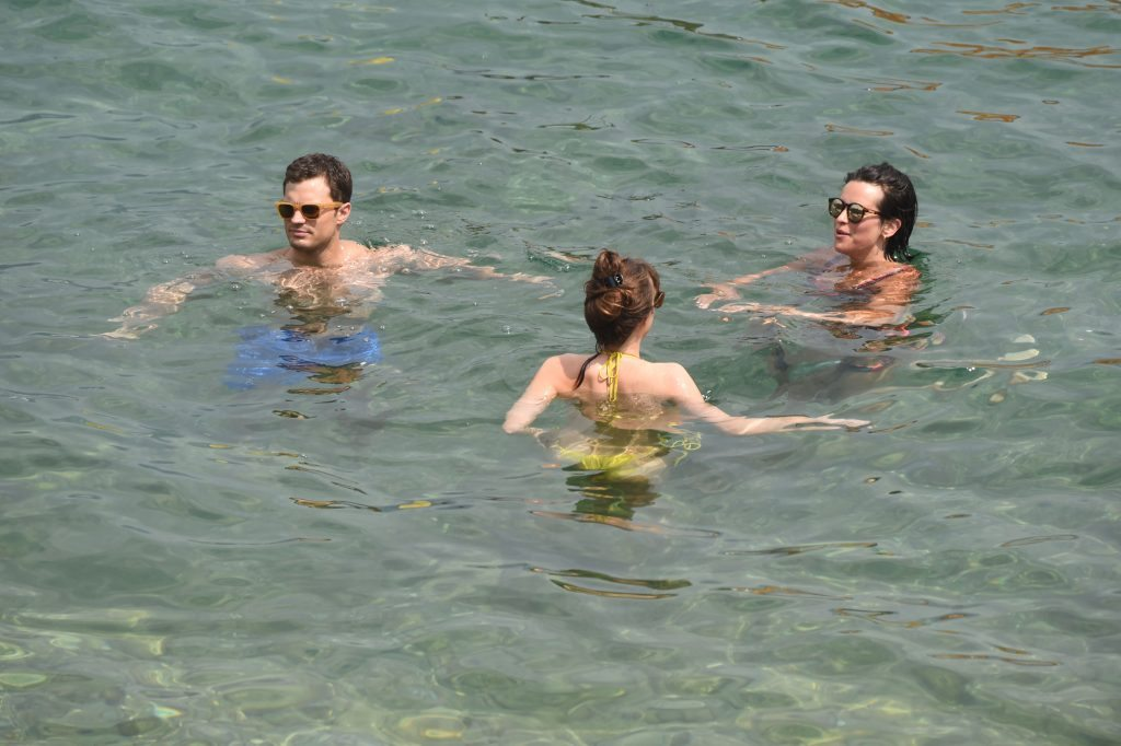12 July 2016. Jamie Dorman has a real life threesome as Dakota Johnson joins Jamie and his wife Amelia Warner for a dip in-between filming scenes , Fifty shades of grey Jamie Dornan and Dakota Johnson are seen filming scenes on the beach in the Côte d'Azu Credit: Neil Warner/GoffPhotos.com Ref: KGC-195